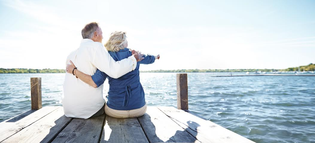Rearview shot of an affectionate senior couple sitting on a pier